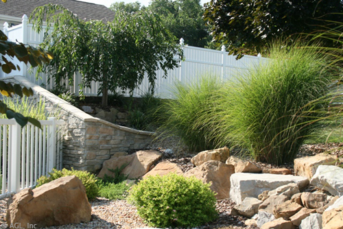 stone wall boulders and grasses