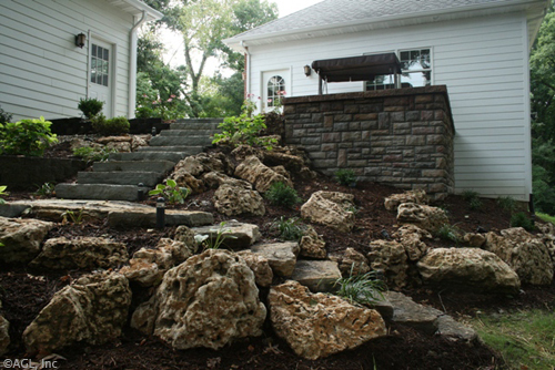 outcropping steps with cultured stonewall